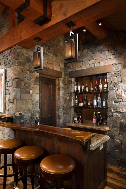 I absolutely LOVE this home bar set up - just look at that rock wall - so warm and rustic looking